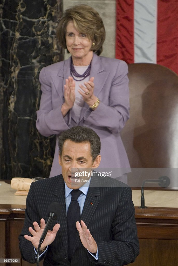French President Nicolas Sarkozy speaks to a joint meeting of Congress as Speaker of the House Nancy Pelosi, D-Calif., applauds his remarks on Wednesday, Nov. 7, 2007.