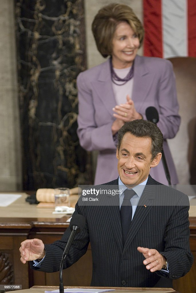 French President Nicolas Sarkozy speaks to a joint meeting of Congress as Speaker of the House Nancy Pelosi, D-Calif., claps on Wednesday, Nov. 7, 2007.
