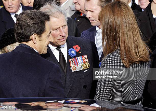 French President Nicolas Sarkozy speaks with Britain's Prince Charles and his wife Carla BruniSarkozy as they leave the Douaumont memorial on...