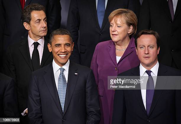 French President Nicolas Sarkozy stands with US President Barack Obama German Chancellor Angela Merkel and British Prime Minister David Cameron...