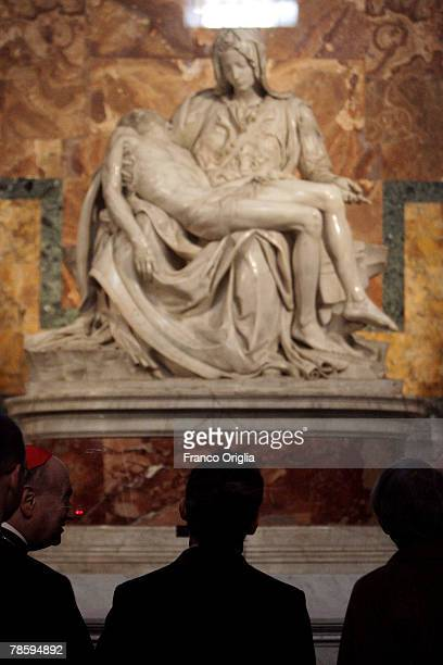 French President Nicolas Sarkozy stops to view the marble statue The 'Pieta' by Michelangelo during a visit to St Peter's Basilica on December 20...