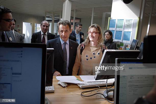 French President Nicolas Sarkozy talks with people during a visit of the Maison de l'emploi 08 october 2007 in Macon central France Sarkozy pledged...