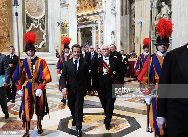 French President Nicolas Sarkozy visits St Peter's Basilica at the end of his meeting with Pope Benedict XVI on October 8 2010 in Vatican City...