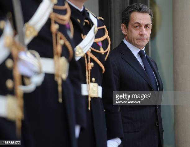 French President Nicolas Sarkozy waits for IMF chief Christine Lagarde to arrive for their meeting at Elysee Palace on January 11, 2012 in Paris,...