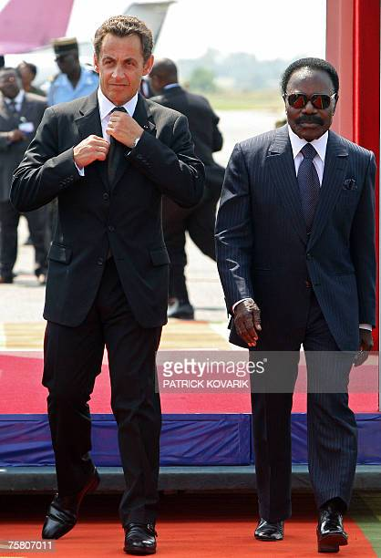 French President Nicolas Sarkozy walks next to Gabonese President Omar Bongo Ondimba after his arrival in Libreville 27 July 2007 Sarkozy arrived in...