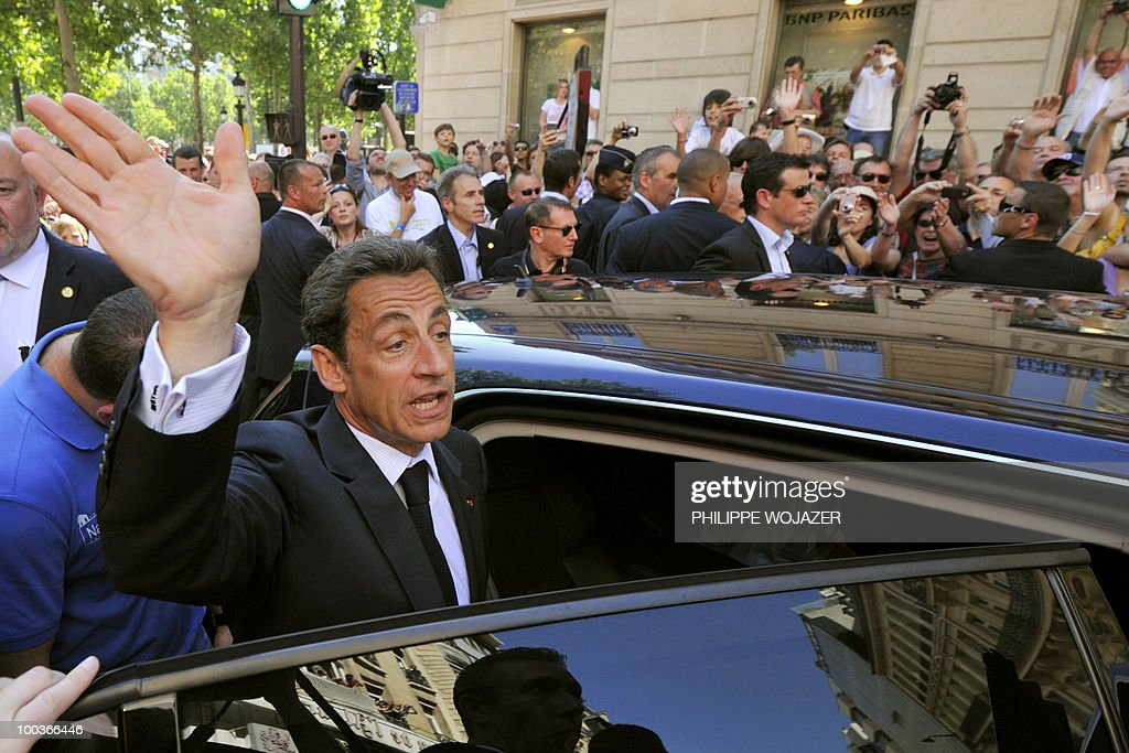 French President Nicolas Sarkozy waves as he enters his car after visiting exhibitions on the Champs-Elysees in Paris, on May 24, 2010. The young French farmers' union organized a two-day event called 'Nature Capitale' where they installed the fields and forest of France in the French capital. The union, representing farmers under the age of 35, aim to showcase farm production from sheep breeding to crop growing and win public support for their embattled sector.