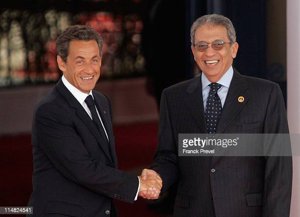 French President Nicolas Sarkozy welcomes Amr Moussa Secretary General of the League of Arab States as he arrives at day two of the G8 summit on May...