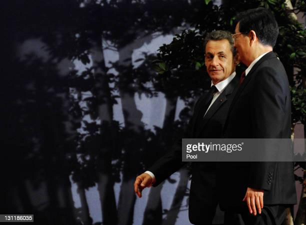 French President Nicolas Sarkozy welcomes Chinese President Hu Jintao prior to their bilateral talks on November 2, 2011 in Cannes, France. The...
