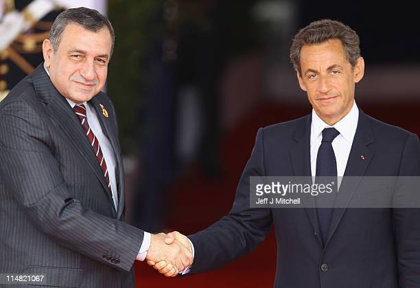 French President Nicolas Sarkozy welcomes Egyptian Prime Minister Essam Sharaf to day two of the G8 Summit on May 27 2011 in Deauville France The...