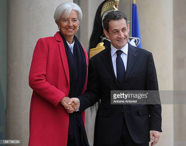 French President Nicolas Sarkozy welcomes IMF chief Christine Lagarde at Elysee Palace on January 11 2012 in Paris France The French President met...