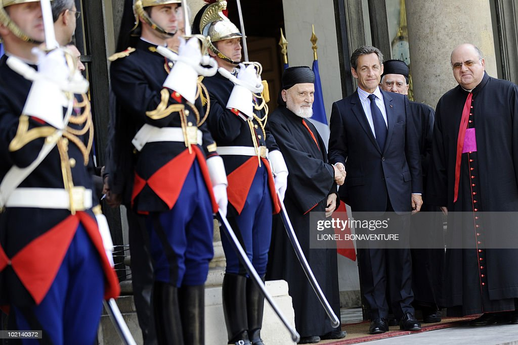 French president Nicolas Sarkozy (2nd R) welcomes Lebanese Maronite Cardinal Nasrallah Boutros Sfeir (L) on June 16, 2010 at the Elysee Palace in Paris, before a meeting.