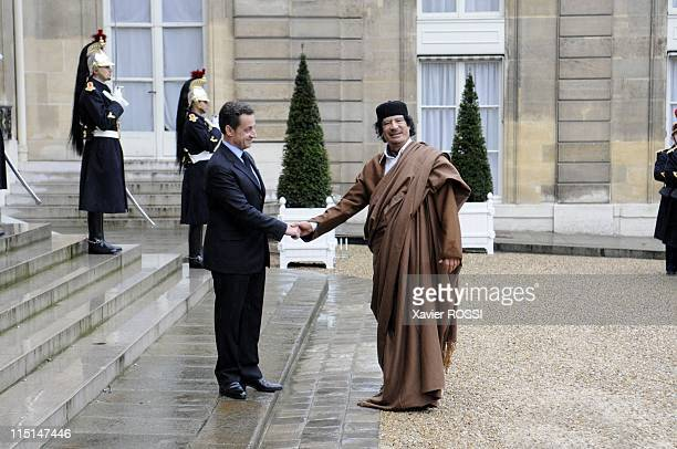 French president Nicolas Sarkozy welcomes Libyan leader Moamer Kadhafi at the French Elysee Palace in Paris France on December 10 2007 French...