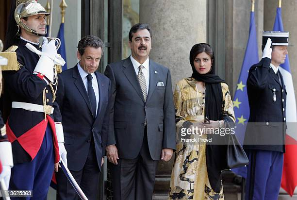 French President Nicolas Sarkozy welcomes Pakistan's Prime Minister Yousuf Raza Gilani and Pakistani State Minister for Finance Revenue and Economic...