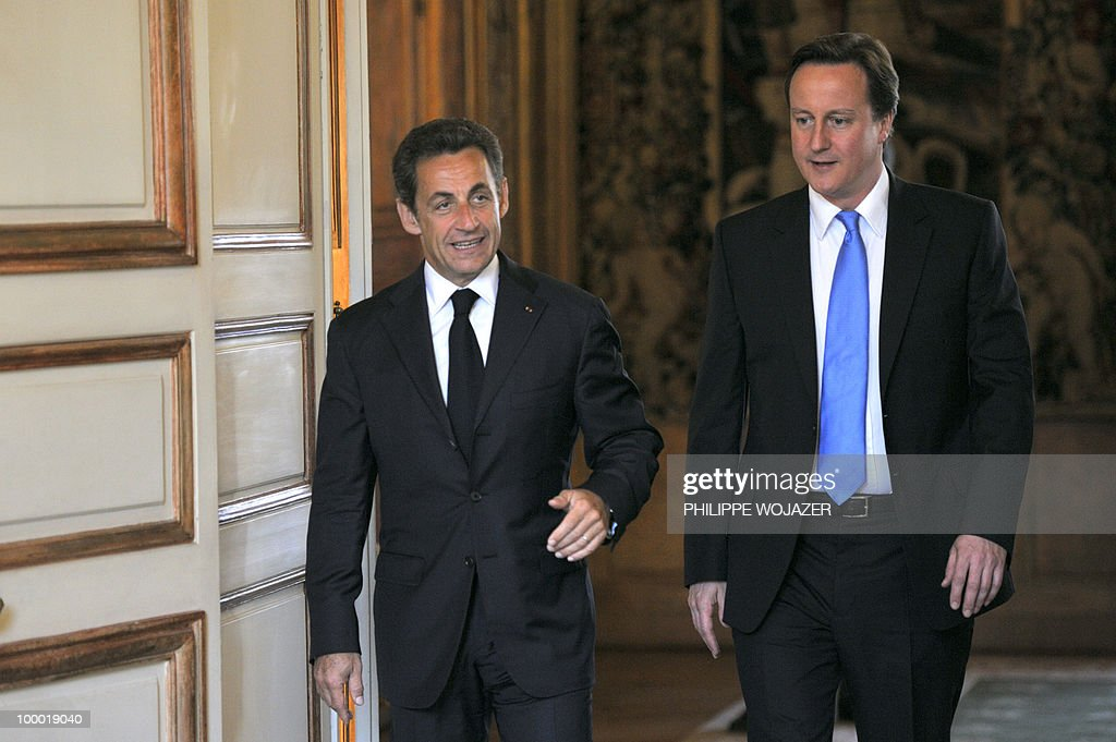 French President Nicolas Sarkozy (L) welcomes the new Britain's Prime minister David Cameron at the Elysee Palace on May 20, 2010 in Paris. Cameron and his coalition deputy unveiled full details today of their 'historic' power-sharing deal, under growing scrutiny for signs of strain.