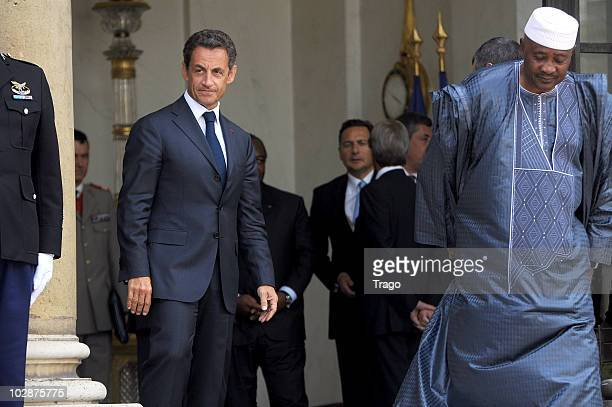 French President Nicolas Sarkozy welcomes the president of Mali Amadou Toumani Toure at the Elysee Palace on July 13 2010 in Paris France Fifty years...