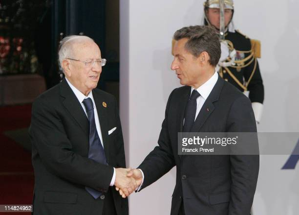 French President Nicolas Sarkozy welcomes Tunisian Prime Minister Beji Caid el Sebsi to day two of the G8 Summit on May 27 2011 in Deauville France...