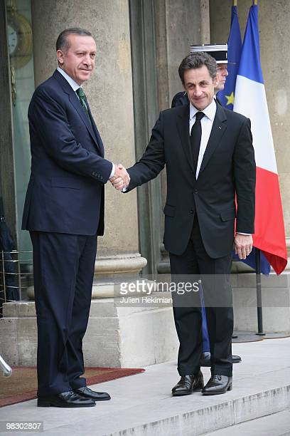 French President Nicolas Sarkozy welcomes Turkish Prime minister Recep Tayyip Erdogan at the Elysee Palace in Paris on April 7 prior to a working...