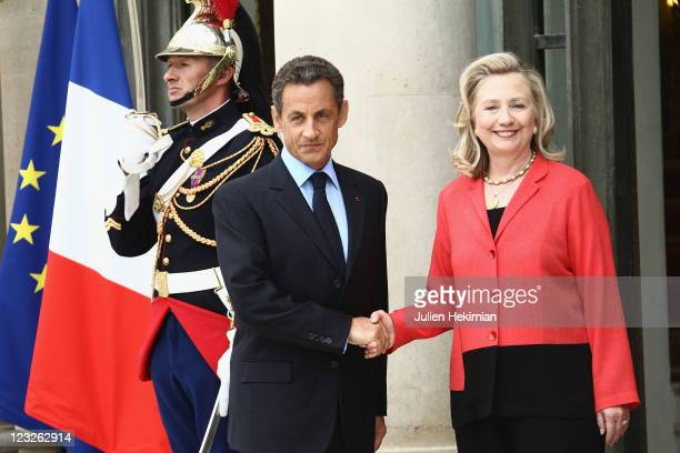 French President Nicolas Sarkozy welcomes US Secretary of State Hillary Clinton before the 'Friends of Libya' International Conference at Elysee...