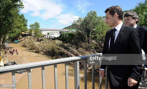 French President Nicolas Sarkozy with Ecology Minister JeanLouis Borloo look at the Nartuby river on June 21 2010 in the French southeastern city of...