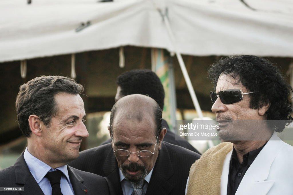 Nicolas Sarkozy and Muammar Gaddafi