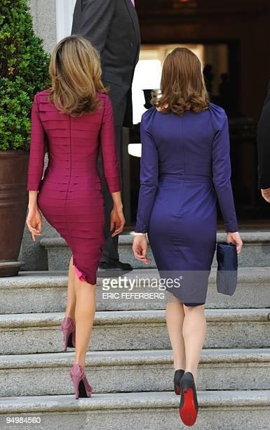French President Nicolas Sarkozy's wife Carla Bruni-Sarkozy and Spain's Princess Letizia walk the stairs of the Zarzuela Palace in Madrid on April...