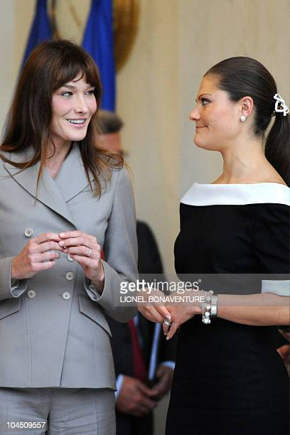 French President Nicolas Sarkozy's wife Carla Bruni-Sarkozy talks with Crown Princess Victoria of Sweden after a meeting at the Elysee presidential...