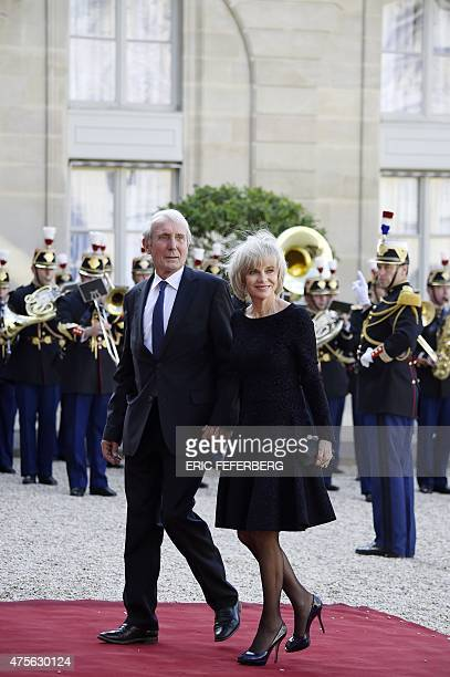 French President of Foreign Affairs Committee at the National Assembly and former Minister Elisabeth Guigou and her husband JeanLouis Guigou arrive...