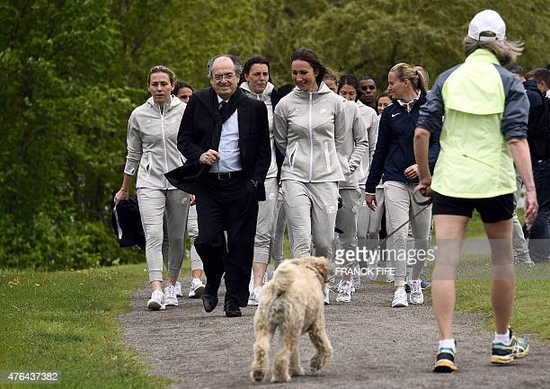French president of the French Football Federation Noel Le Graet speaks with France's forward Gaetane Thiney before their Group F match at the 2015...