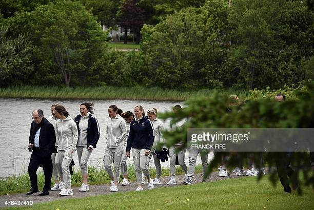 French president of the French Football Federation Noel Le Graet walks with French players before their Group F match at the 2015 FIFA Women's World...