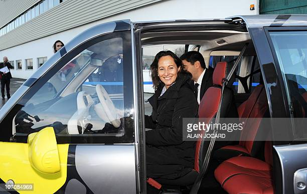 French President of the Poitou regional council Socialist Segolène Royal leaves after testing a Mia car as she attends the launching of the...