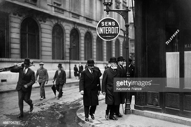 French President Paul Doumer walks out of the Elysee Palace to the voting poll circa 1930 in Paris France