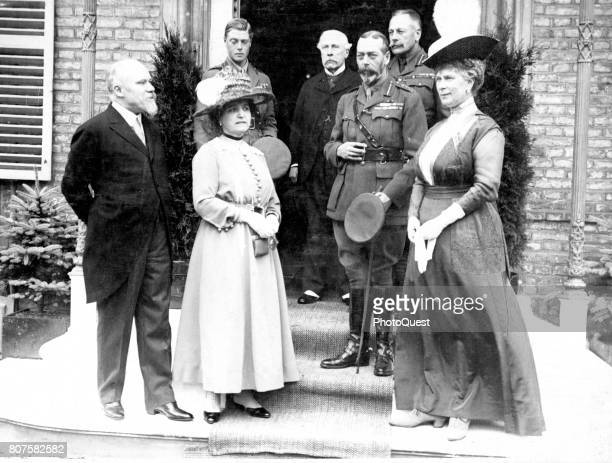 French President Raymond Poincare and his wife Henriette Poincare pose with King George V and Queen Mary of England Abbeville France July 10 1917...