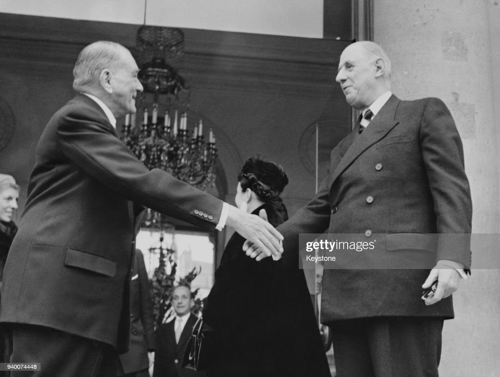 French President René Coty (1884 - 1962, left) shakes hands with his successor, General de Gaulle (1890 - 1970) after lunch at the Elysée Palace in Paris, France, 23rd December 1958. De Gaulle will become President of the Fifth Republic on 8th January 1959.