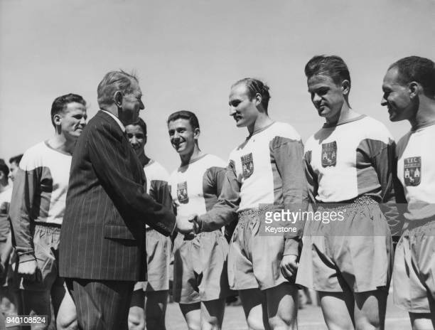 French President René Coty shakes hands with the Toulouse football team after they beat Angers 6:3 in the 1957 Coupe de France final, 26th May 1957.