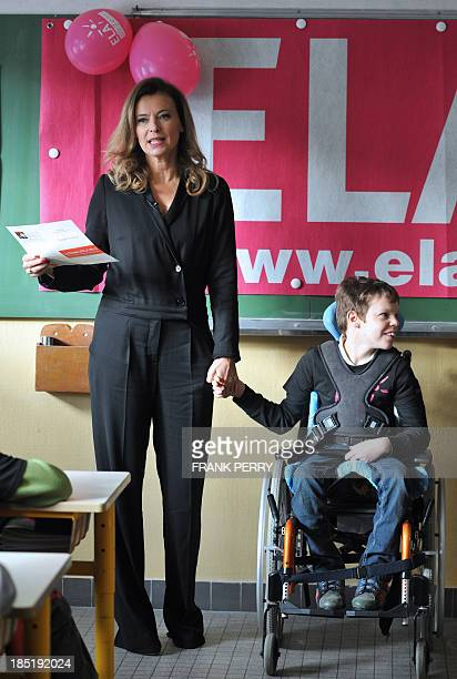 French President' s companion Valerie Trierweiler addresses pupils during a visit in a classroom to support the ELA on October 18 2013 at the Paul...