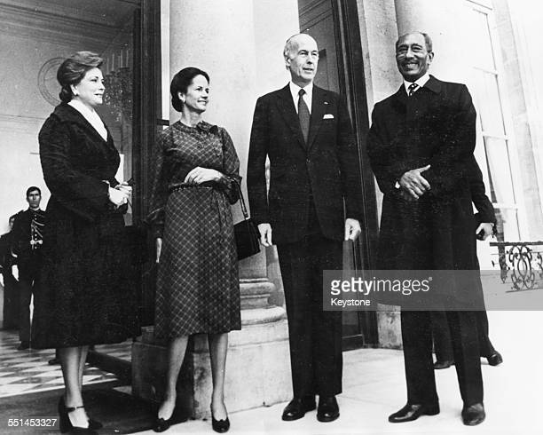 French President Valery Giscard d'Estaing and his Egyptian counterpart Anwar Sadat with their wives meeting on a European tour in Paris February 16th...
