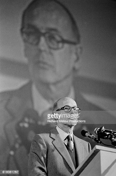 French President Valery Giscard d'Estaing gives a speech while a large image of his face is projected behind him. Giscard d'Estaing's speech closed...