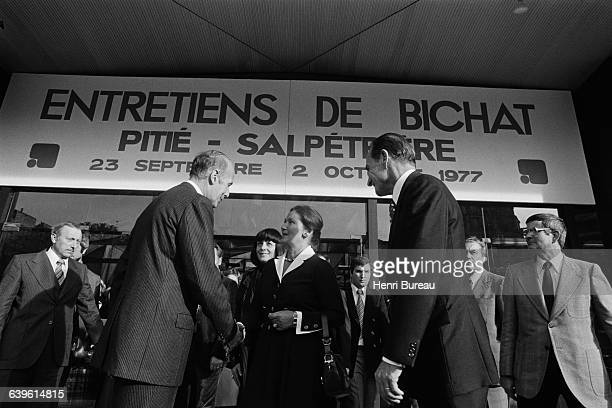 French President Valery Giscard d'Estaing is welcomed by Simone Veil and Alice SaunierSeite at the Bichat interviews