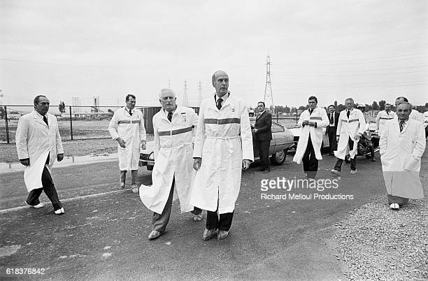 French President Valery Giscard d'Estaing surrounded by government officials and nuclear power plant workers visits a nuclear power plant in...