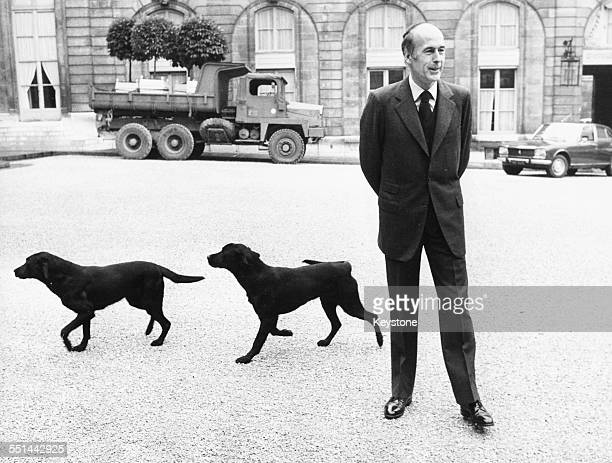 French President Valery Giscard D'Estaing with his two labradors in the grounds of the Elysee Palace, with a military truck in the background, Paris,...