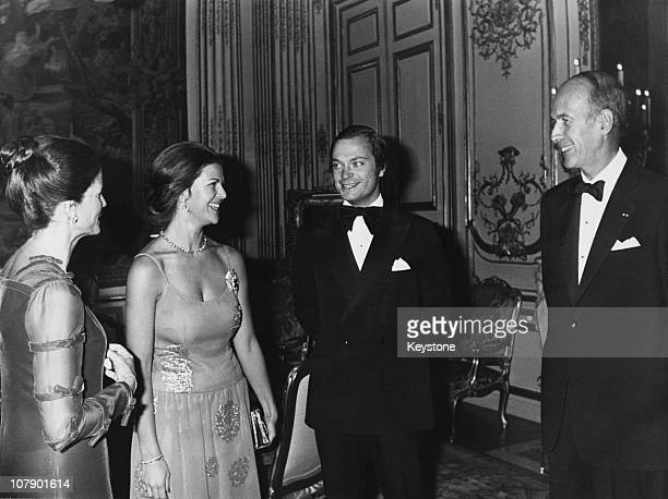 French President Valery Giscard d'Estaing with King Carl Gustaf XVI and Queen Silvia of Sweden, at the Elysee Palace, Paris, 10th November 1976. On...