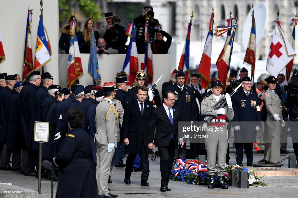 French president-elect Emmanuel Macron and outgoing French President Francois Hollande attend a ceremony to mark the Western allies' World War Two victory in Europe at the Arc De Triumphe on May 8, 2017 in Paris, France. The ceremony marks the 72nd anniversary of the victory over Nazi Germany in 1945.