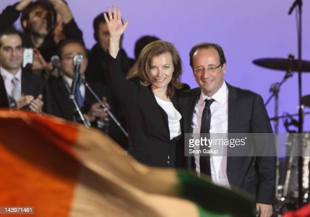 French PresidentElect Francois Hollande and his partner Valerie Trierweiler greet thousands of gathered supporters at Place de la Bastille after...