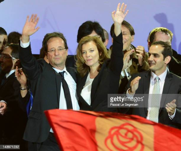 French PresidentElect Francois Hollande and partner Valerie Trierweiler acknowledge his supporters at Place de la Bastille after victory in the...