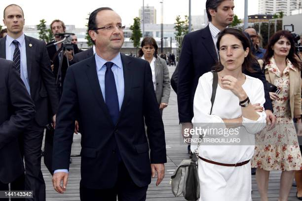 French Presidentelect Francois Hollande arrives with Mazarine Pingeot the daughter of late President Francois Mitterrand a red rose in their hand for...