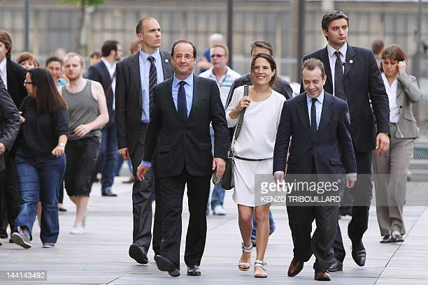 French Presidentelect Francois Hollande arrives with Mazarine Pingeot the daughter of late President Francois Mitterrand for a visit at the Francois...