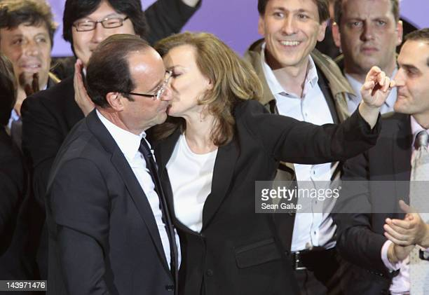 French PresidentElect Francois Hollande gets a kiss from his partner Valerie Trierweiler as he greetd thousands of gathered supporters at Place de la...