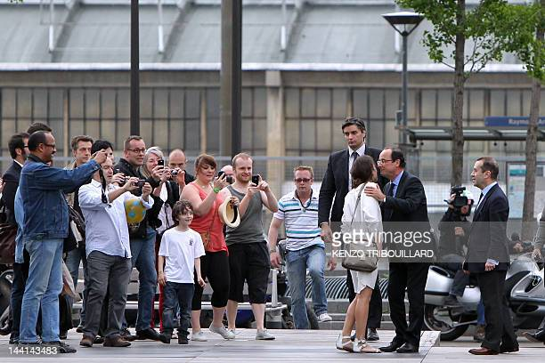 French Presidentelect Francois Hollande kisses Mazarine Pingeot the daughter of late President Francois Mitterrand as people take photos before a...
