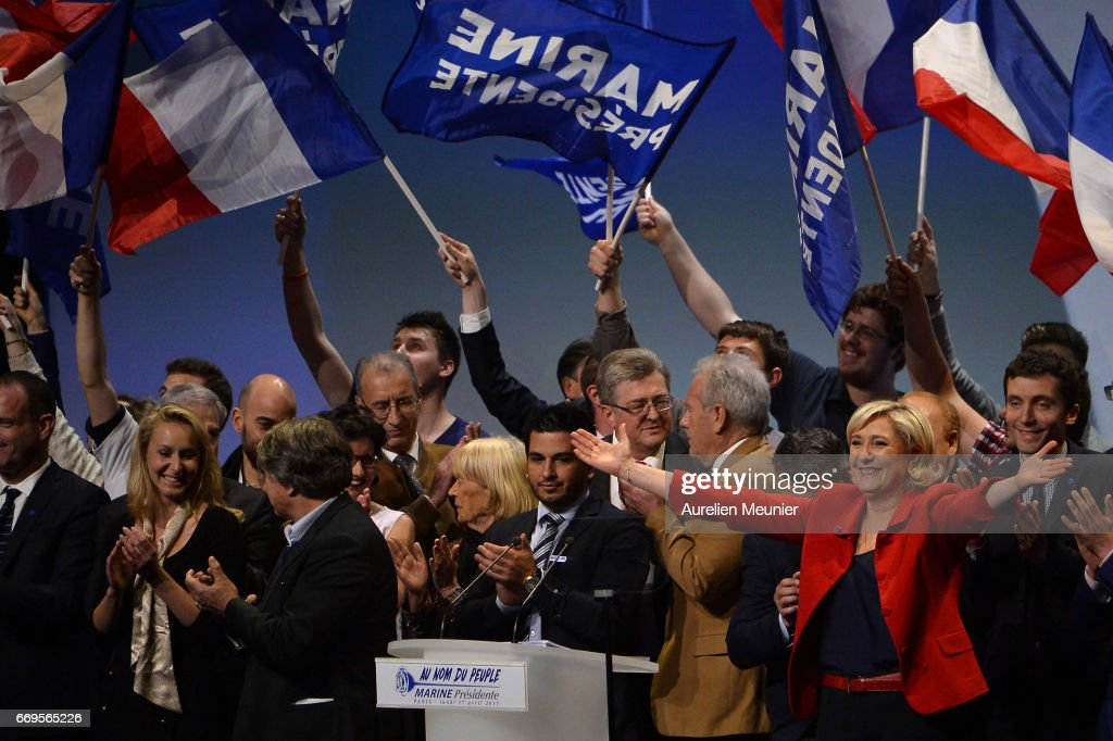 French Presidential Candidate and leader of the National Front Party Marine Le Pen salutes voters after a political meeting on April 17, 2017 in Paris, France. During one of her last meeting before the first round of the Presidential Election in 6 days, Marine Le Pen talked mostly about immigration and setting back the frontiers.