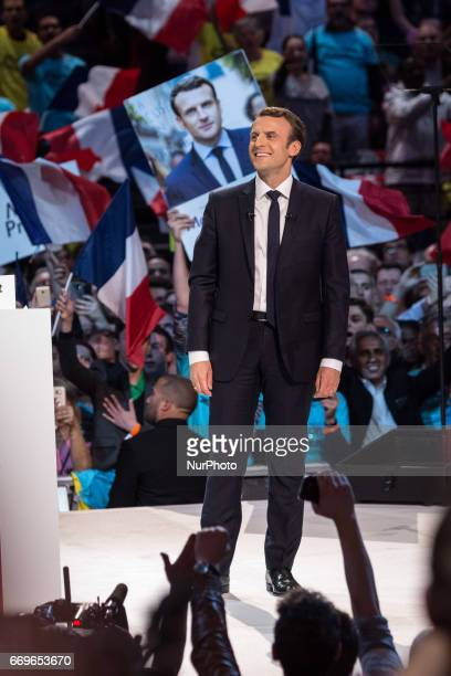 French Presidential Candidate Emmanuel Macron addresses voters during a political meeting on April 17 2017 in Paris France Thousands of supporters...